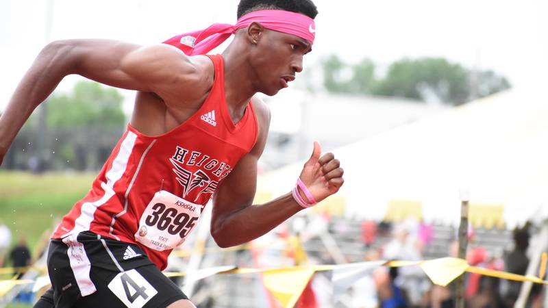 Wichita Heights Elijah Mosley battled a nagging injury but still claimed 6A titles in the 200m...