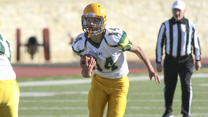 Olpe Eagle #14 Damon Redeker takes off on a quarterback run in the third quarter.  The Olpe...