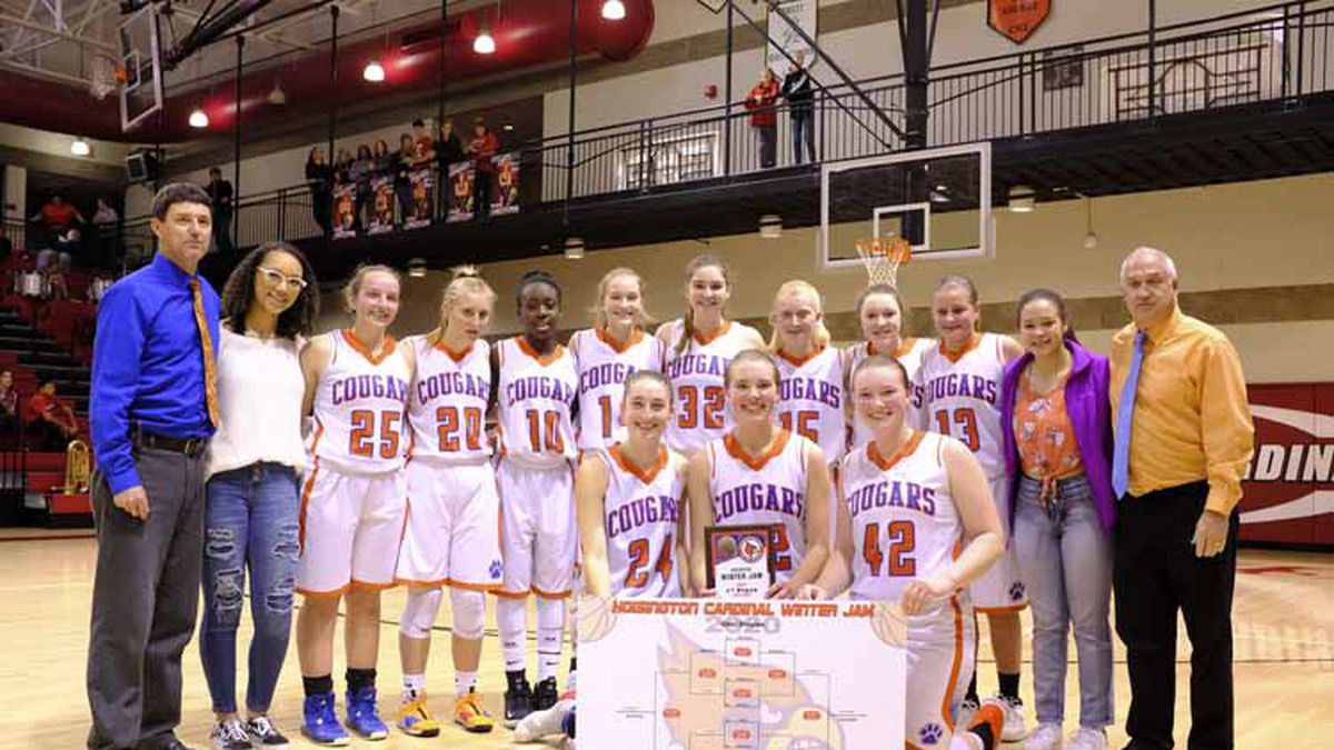 The Otis-Bison Lady Cougars line up for a picture with the tournament bracket and Championship trophy.  The Otis-Bison Lady Cougars defeated the Ellinwood Lady Eagles by a score of 49 to 16 to win the Girls Championship game of the 2020 Hoisington Winter Jam Tournament held at the Hoisington Activity Center in Hoisington, Kansas on January 25, 2020.  (Photo: Joey Bahr, www.joeybahr.com)