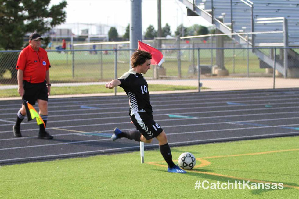 Maize South senior Adam Dyer delivers a corner kick in the second half of their match with...