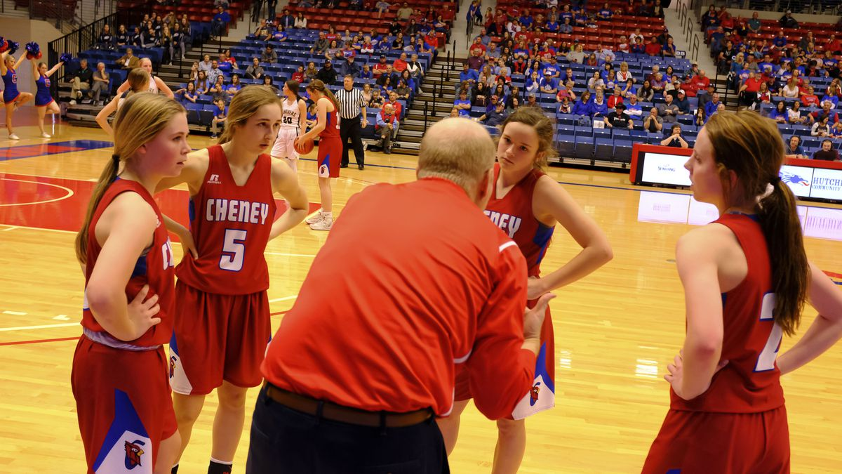 Cheney Lady Cardinal Head Coach Rod Scheer addresses his players during a timeout.  Teams...