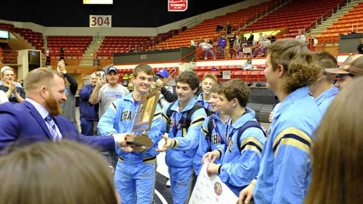 Chanute's head coach hands the team State Championship trophy to his wrestlers.  The KSHSAA Class 4A State Wrestling Tournament concluded at Tony's Pizza Event Center in Salina, Kansas on February 29, 2020.  (Photo: Joey Bahr, www.joeybahr.com)
