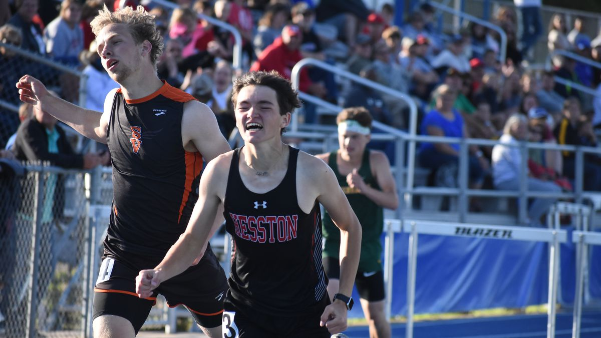 Hesston's Devin Miller edges Smoky Valley's Stephen Peterson in the 300m hurdles for Thursday's...