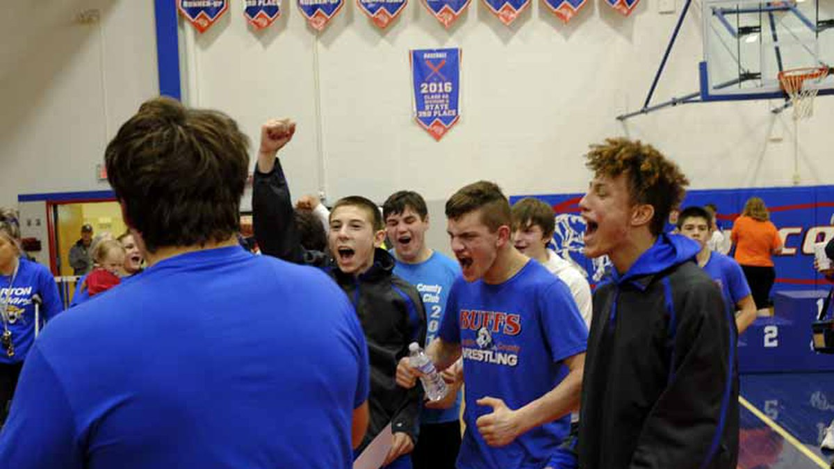 Members of the Republic County team cheer as the they accept the 321A Regional Tournament...