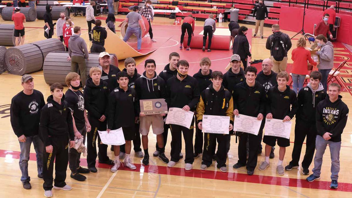 The Andale team poses for a picture with the Sub-State Team Champion trophy.  Wrestlers...