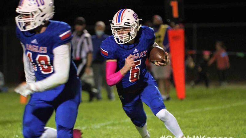 Canton-Galva's Garrett Maltbie carries the ball in the first half of their game with Little River