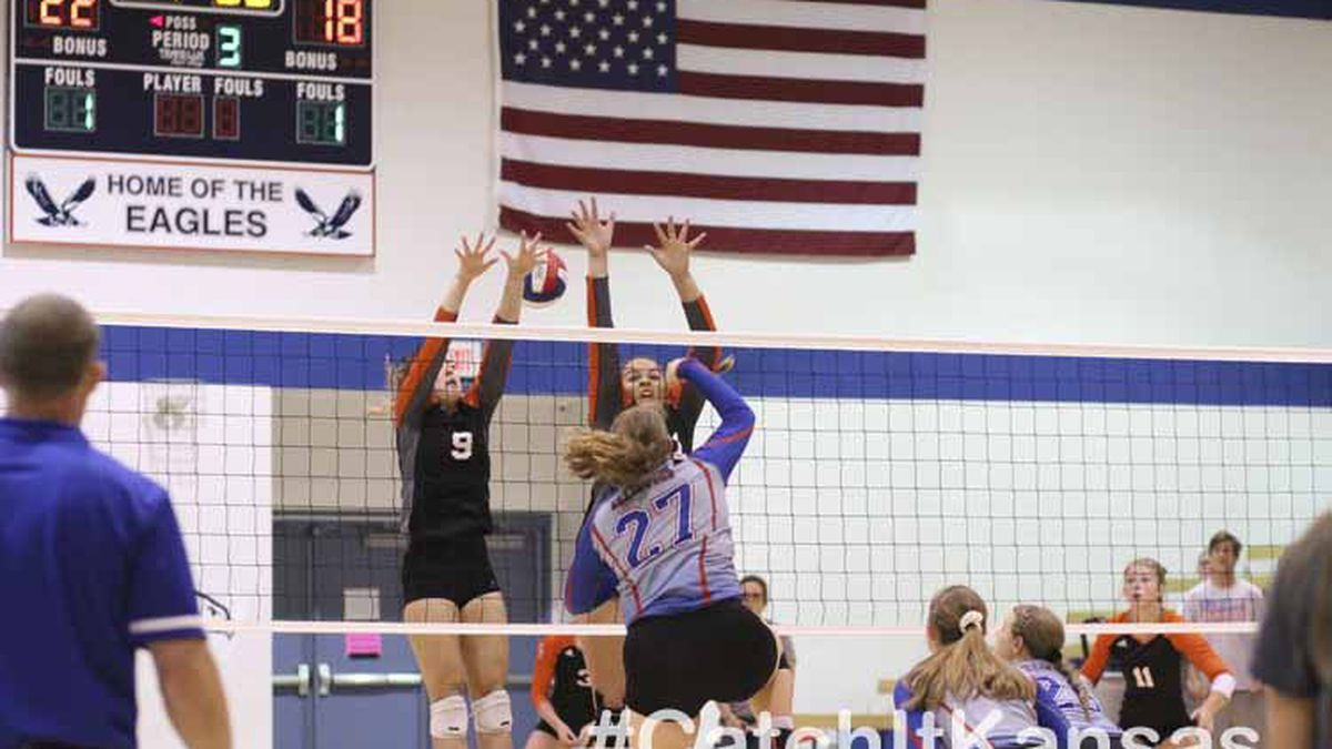 Ellinwood Lady Eagle #27 Allison McReynolds hits the ball through the block of Smoky Valley Lady Vikings #9 Belle Peters and #42 Bri Franklin.  Ellinwood hosted a volleyball triangular with Smoky Valley and Great Bend at Ellinwood High School in Ellinwood, Kansas on September 19, 2019.  (Photo: Joey Bahr, www.joeybahr.com)