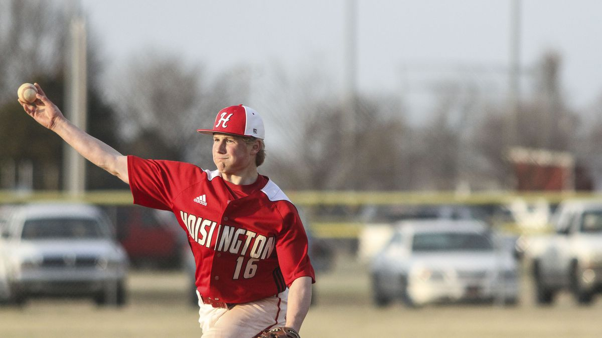 Hoisington Cardinal #16 Holt Hanzlick throws a pitch in the top of the third inning.  The Hoisington Cardinals defeated the Nickerson Panthers 5 to 4 in the Eighth Inning in the second game of a double header held at Leigion Field in Hoisington, Kansas on March 26, 2019.  (Photo: Joey Bahr, www.joeybahr.com)