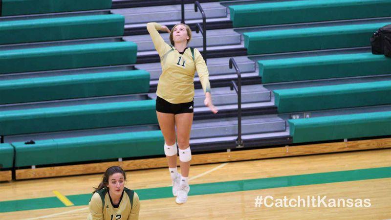 Ella Larkin playing volleyball at Bishop Carroll.