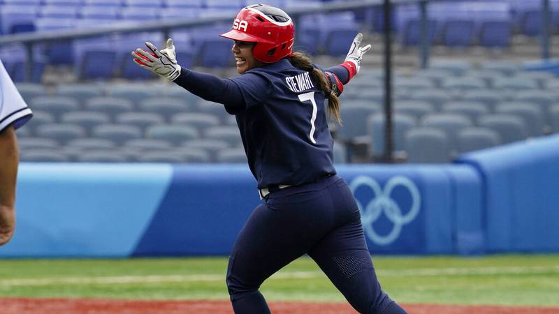 United States' Kelsey Stewart (7) celebrates her game winning home run against Japan in the...