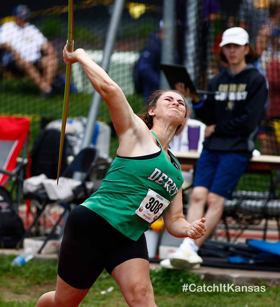 Derby's Callie Knudson launches the javelin in the state track and field meet in Wichita...