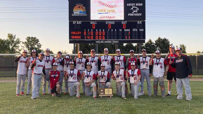 The Sedgwick Cardinals line up in front of the score board to celebrate winning the State...
