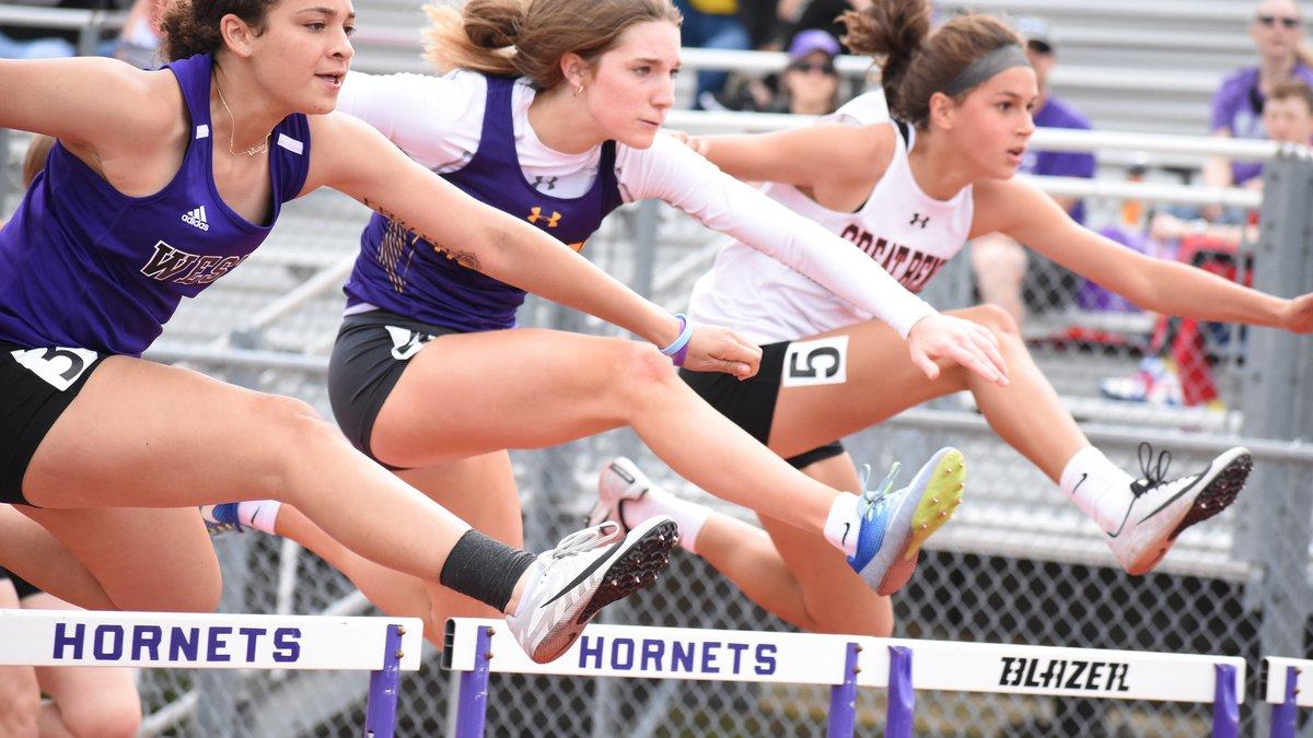 Valley center junior Anna Eldridge (center) ran her best 100m hurdle time of the season for the...