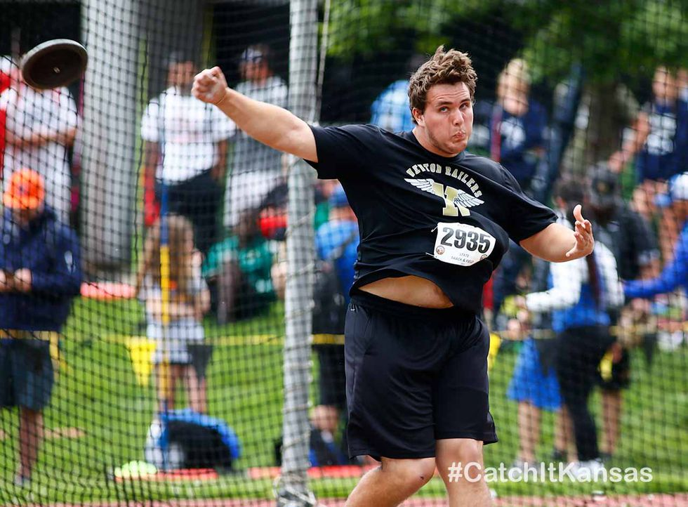 Newton's Aiden Kendall throws the discus in the state track and field meet in Wichita Thursday....