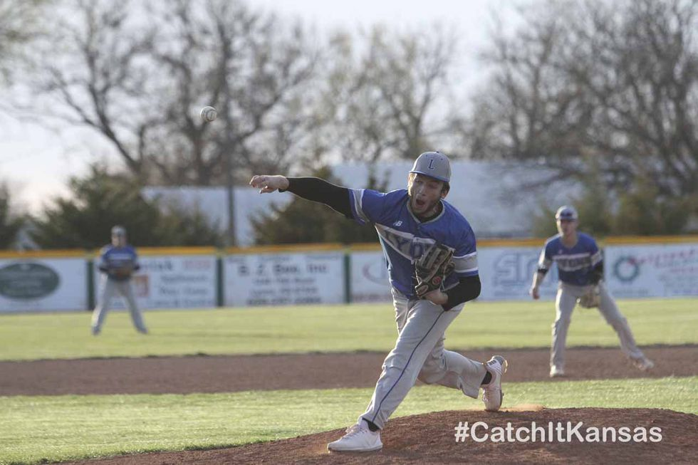 Lions Lyon #30 Gabe Riffel throws a pitch.  The Hoisington Cardinals and Lyons Lions split a...