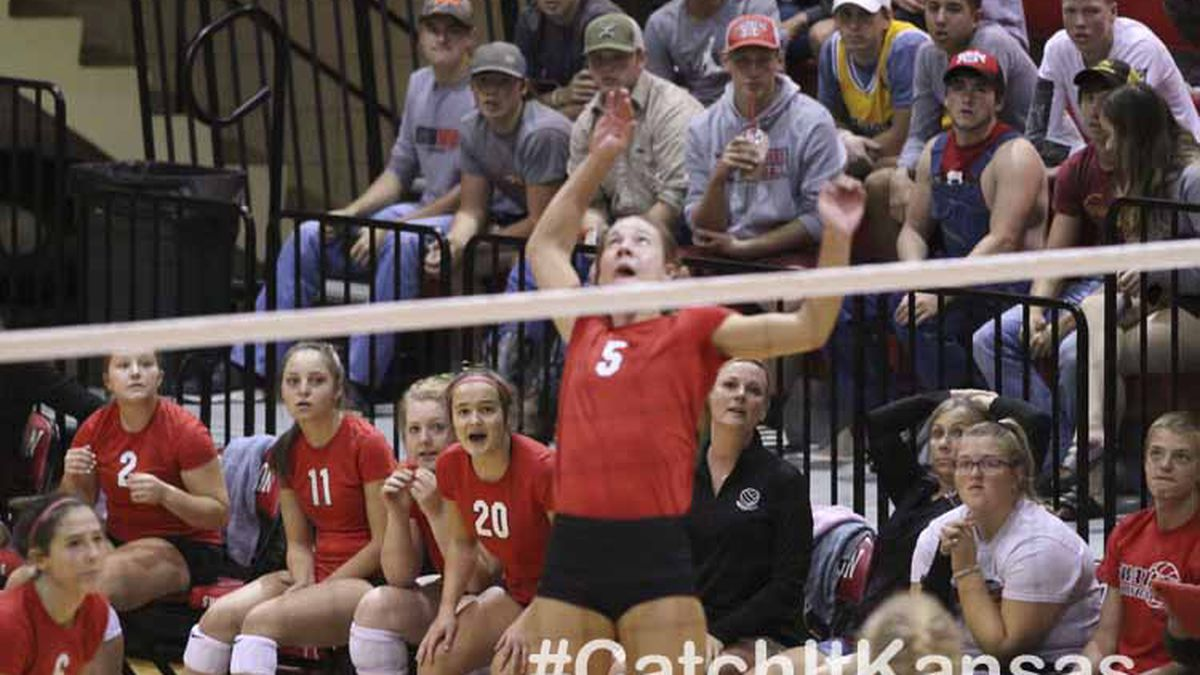 Teammates watch as Hesston Lady Swather #5 Elise Kaiser prepares to hit the ball.  The teams of the Central Kansas League gathered for the League Preseason Volleyball Tournament held at Hesston High School in Hesston, Kansas on August 31, 2019.  (Photo: Joey Bahr, www.joeybahr.com)