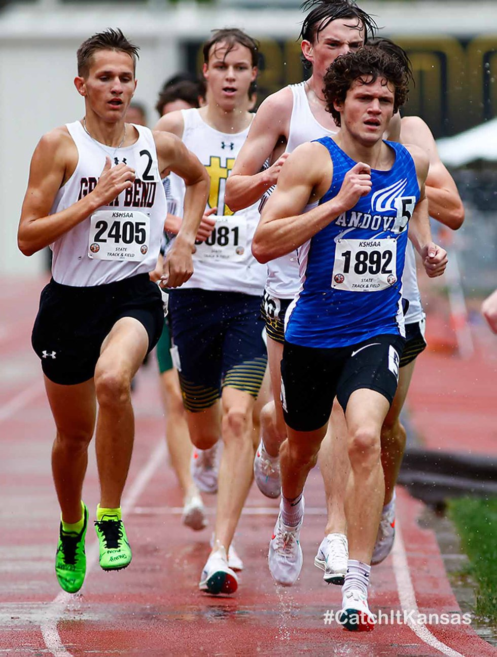 AndoverÕs Sam McDavitt, right, leads a pack of runners at the state track and field meet in...