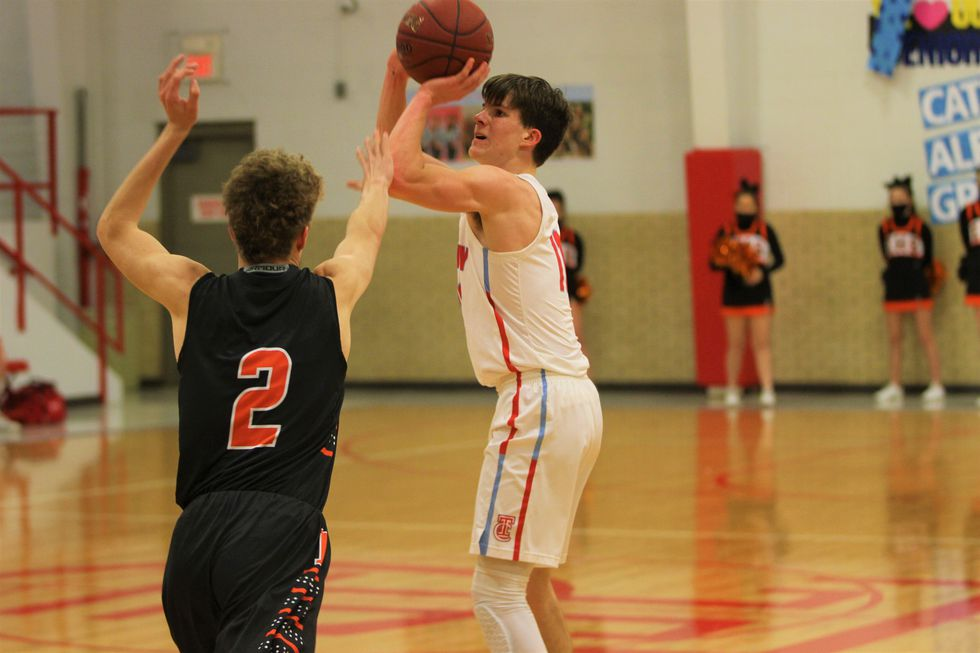 Trinity Catholic's Lucas Hammeke beats the third quarter buzzer with a three. He finished with...