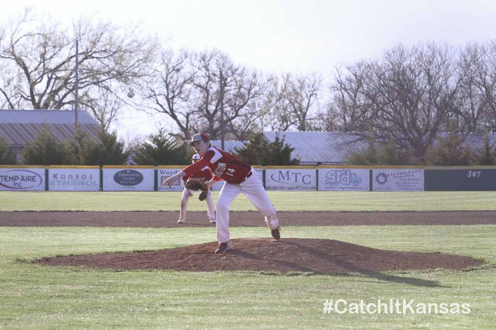 Hoisington Cardinal #14 Tony Moore throws a pitch.  The Hoisington Cardinals and Lyons Lions...