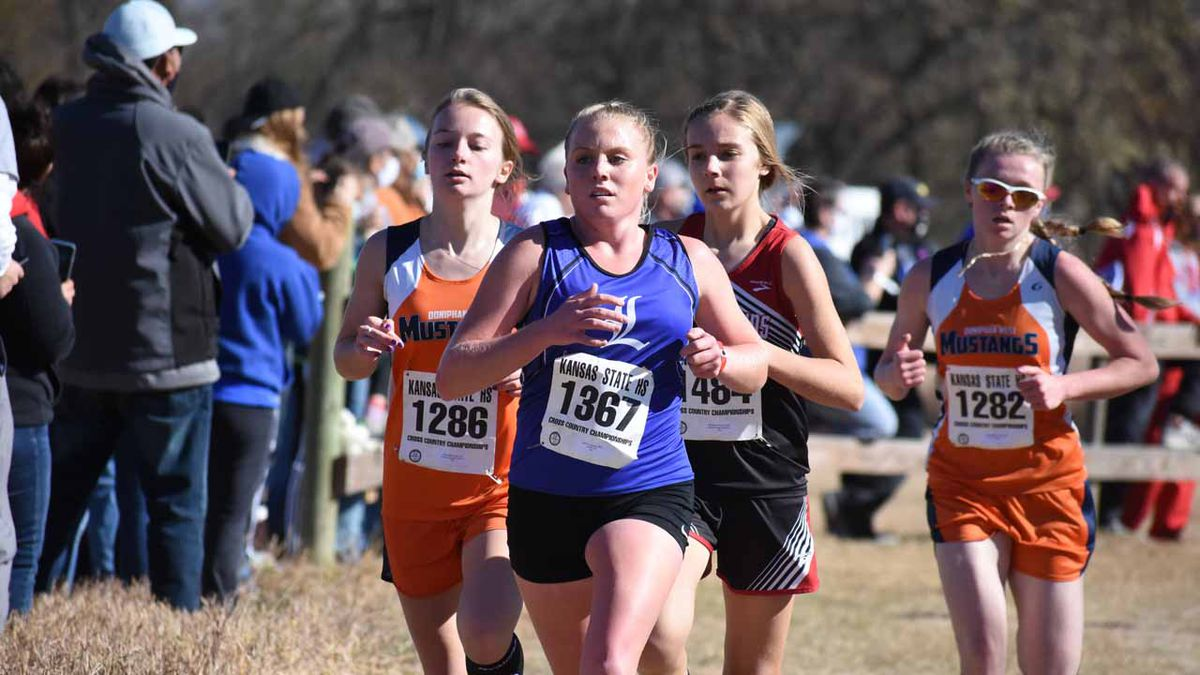Meade's boys and Doniphan West's girls won team titles at 1A State Cross Country Saturday in...