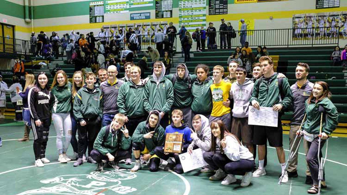 The Pratt Greenback wrestlers gather with the regional championship trophy after the completion of the tournament.  A KSHSAA Class 4A Regional Wrestling Tournament was held at Pratt High School in Pratt, Kansas on February 16, 2019.  (Photo: Joey Bahr, www.joeybahr.com)